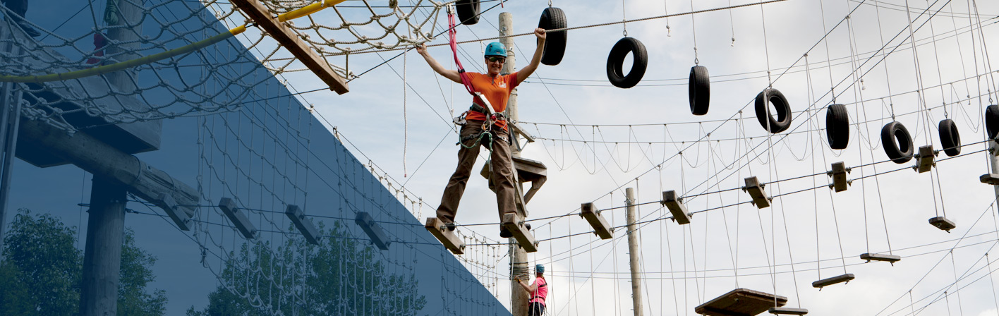 person on high ropes course